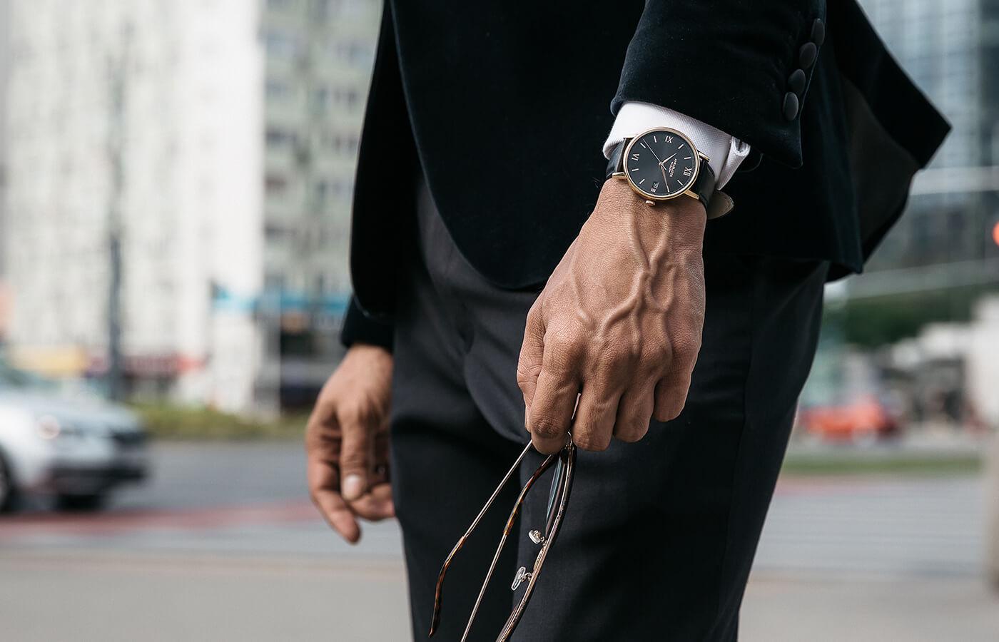 man holding watch under $200