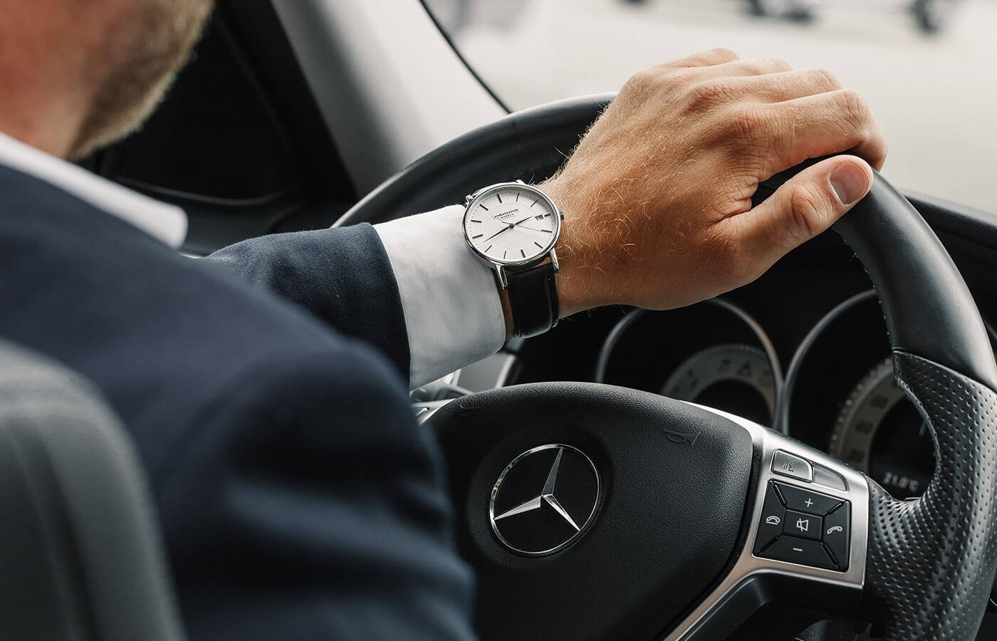 men driving luxury car